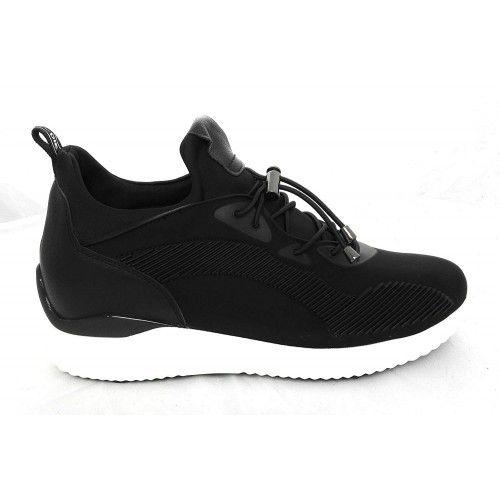 Zapatos deportivos de mujer...