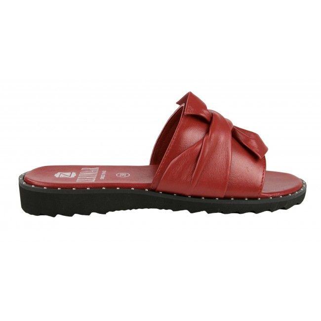 Sandalias planas de piel con lazo y tachuelas